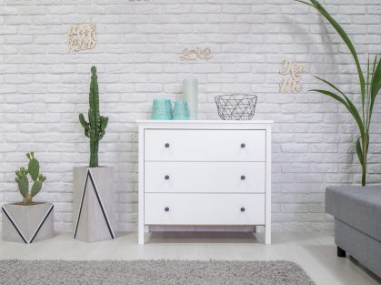 Home interior with white dresser
